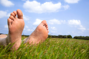 Earthing - bare feet on the grass